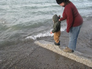 Little kid testing the waters at Lake Erie