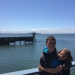 Jessica hugging Nathan at the bay in Eureka California