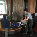 Brandon helping a ranger to fold the flag