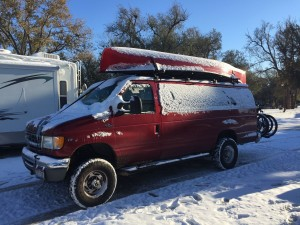The van covered in a little snow after the snowstorm