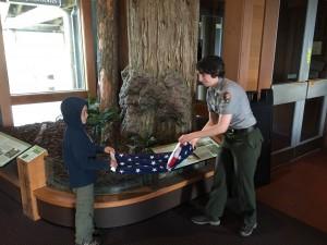 Brandon helping a ranger to fold the flag