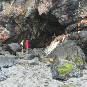 Kids exploring a small cave