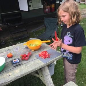 Jessica cutting strawberries
